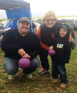 Lacey with husband Joe and son Ryan at recent purple pumpkin day