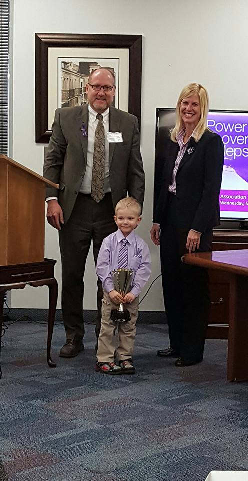 Ryan  receiving his award at the Epilepsy Association's Power Lunch. Award presented by Board President, Peter Nelson and CEO, Kelley Needham